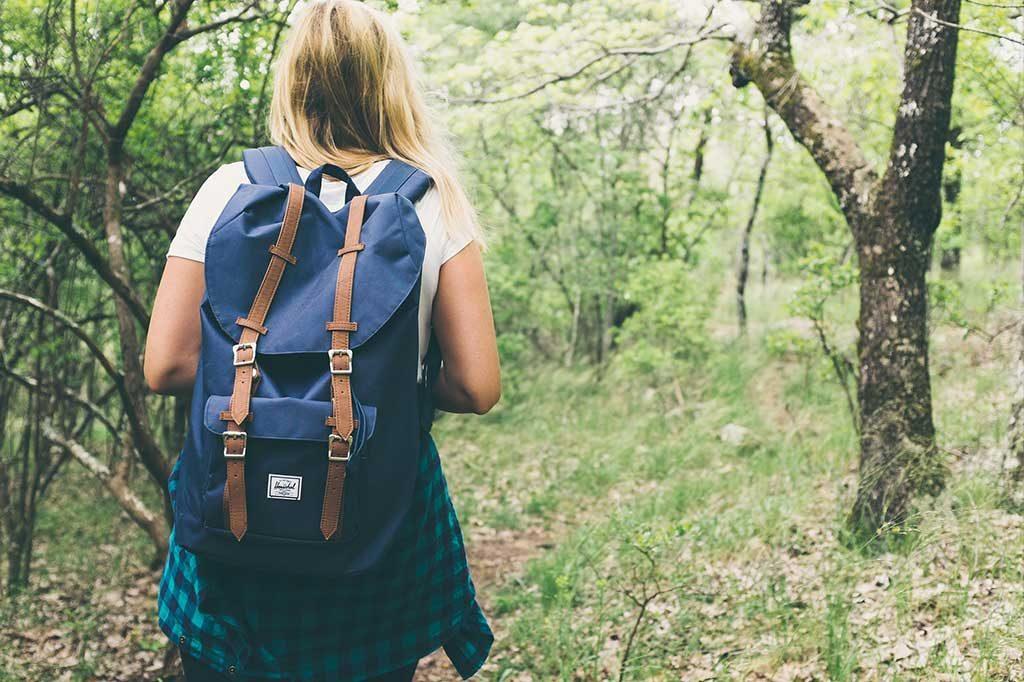 Teen girl hiking on a path