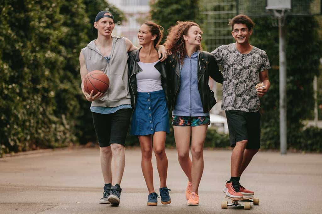 Four teenagers walking together