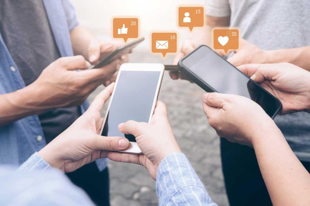 Teenagers engaging in social media on smartphones